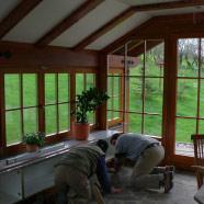 Wintergartenanbau zur Hauseingangsnutzung mit Einbaumöbel